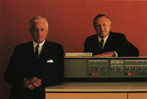 IBM chairman and president with an IBM 360 computer, circa 1970