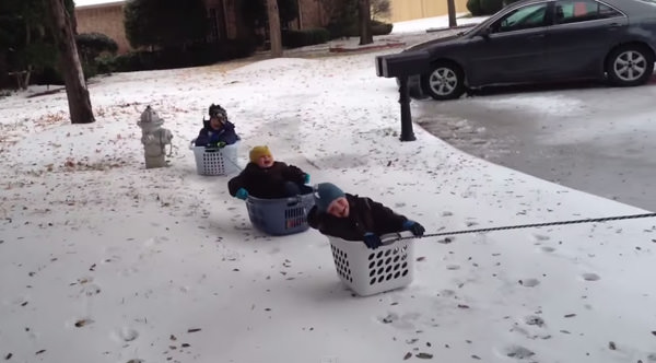 dad-takes-kids-sledding