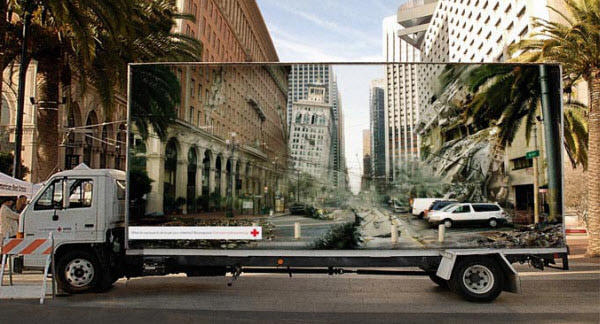 red cross optical illusion billboard