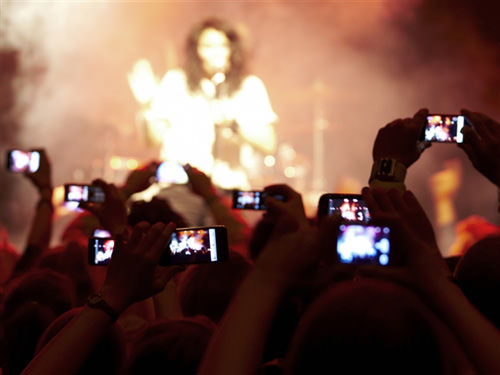 Snapping Photos At A Concert