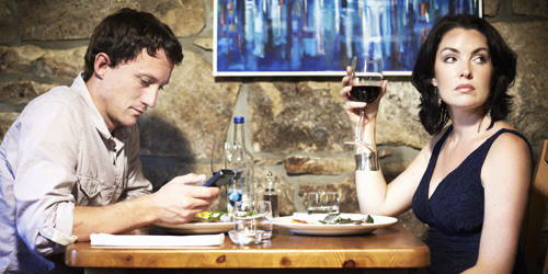 Using A Smartphone During Dinner