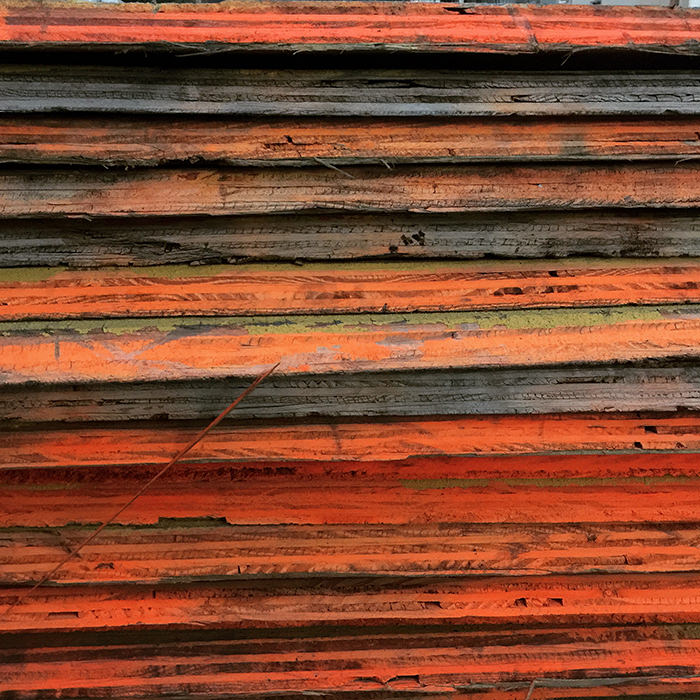 Wooden boards with orange fluorescent paint