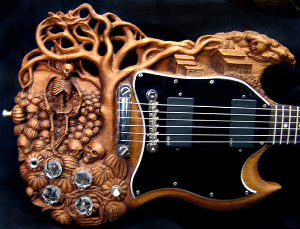 Carved Guitar by Doug Rowell